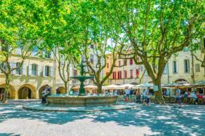 UZES, FRANCE, JUNE 20, 2017: Place aux Herbes in the center of Uzes, France